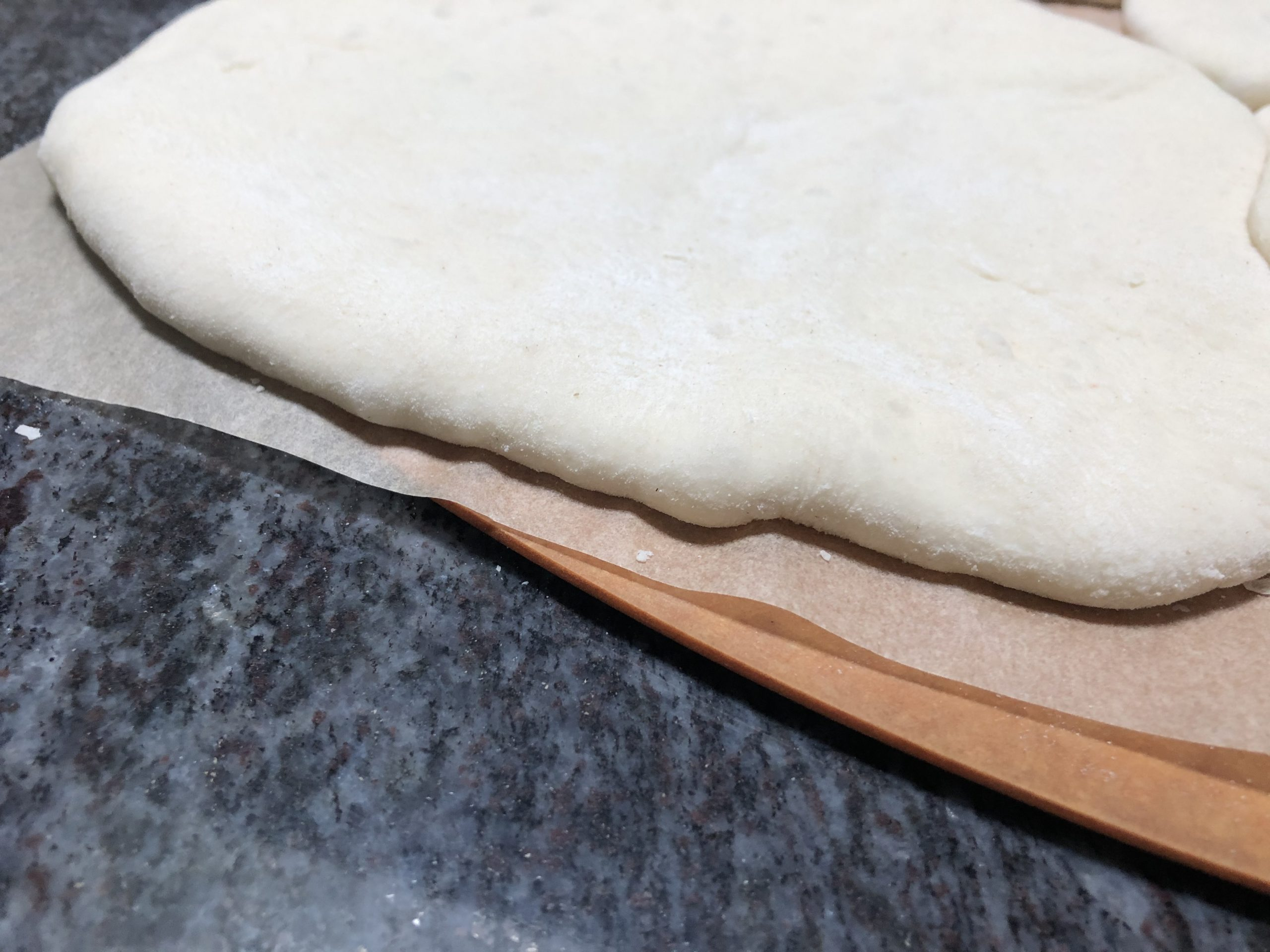 rested dough on pizza peel